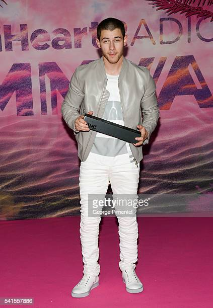 Nick Jonas poses in the press room at the 2016 iHeartRADIO MuchMusic Video Awards at MuchMusic HQ on June 19 2016 in Toronto Canada