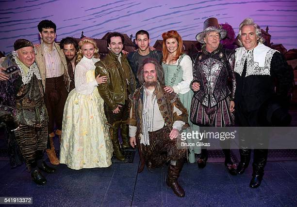 Nick Jonas poses with the cast backstage at the hit musical Something Rotten on Broadway at The StJames Theatre on June 20 2016 in New York City