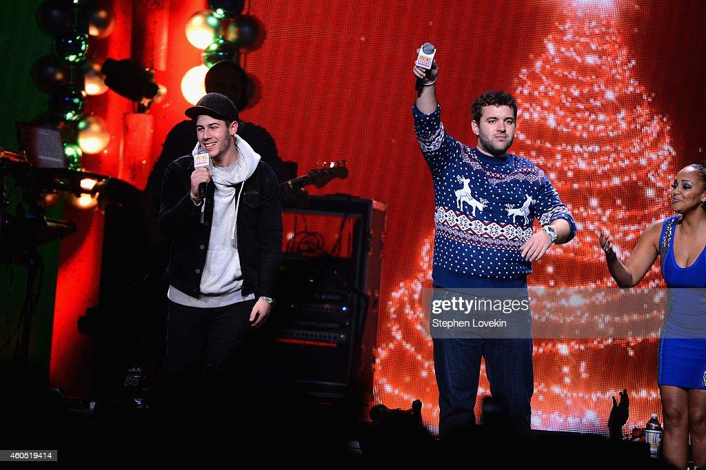 Nick Jonas, radio personalities Intern John and Danni of
