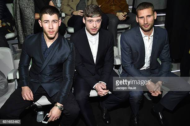 Nick Jonas, Richard Madden and Edward Holcroft attend the Emporio Armani show during Milan Men's Fashion Week Fall/Winter 2017/18 on January 14, 2017...