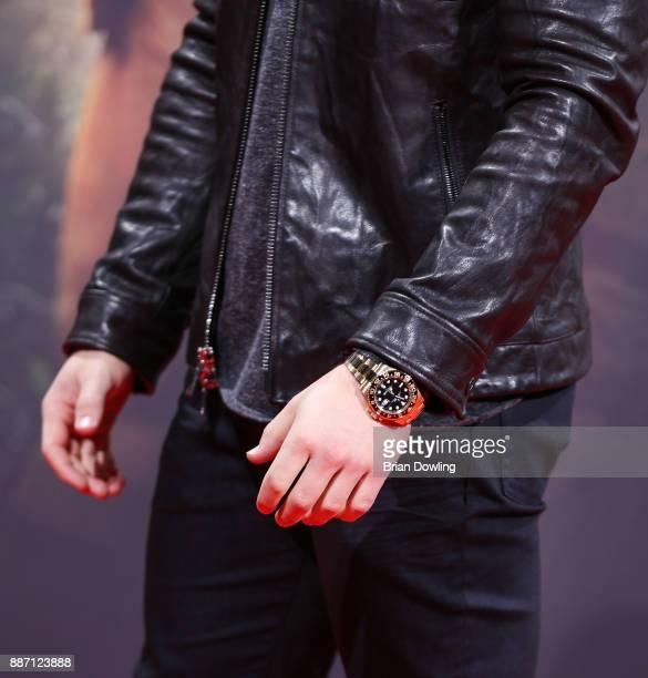 Nick Jonas seen wearing a 18ct yellow gold Rolex Submariner Date Watch arrives at the German premiere of 'Jumanji Willkommen im Dschungel' at Sony...