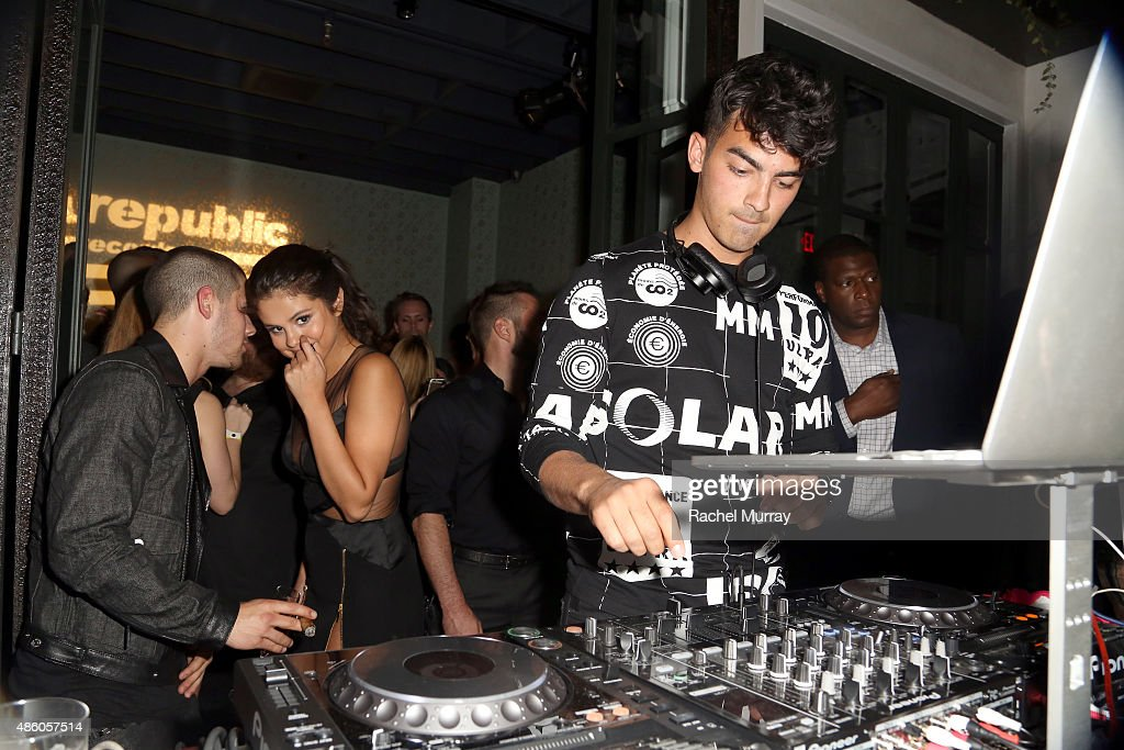Nick Jonas, Selena Gomez and Joe Jonas attend Republic Records 2015 VMA after party at Ysabel on August 30, 2015 in West Hollywood, California.