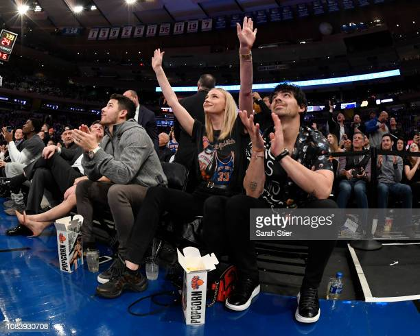 Nick Jonas Sophie Turner and Joe Jonas take in the New York Knicks game against the Phoenix Suns at Madison Square Garden on December 17 2018 in New...