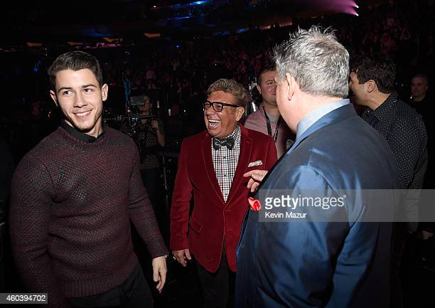 Nick Jonas Uncle Johnny and Elvis Duran speak backstage at iHeartRadio Jingle Ball 2014 hosted by Z100 New York and presented by Goldfish Puffs at...