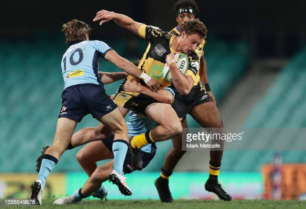 Nick Jooste of the Force Is tackled by Will Harrison of the Waratahs during the round 2 Super Rugby AU match between the Waratahs and the Western...