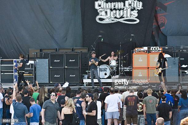 Nick Kay John Allen Jason Heiser and Vic Karrera of the Charm City Devils performs at Crue Fest 2 at the San Manuel Ampitheater on July 31 2009 in...