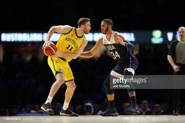 Nick Kay of the Australian Boomers handles the ball while Jayson Tatum of Team USA plays defense during the game on August 24 2019 at Marvel Stadium...