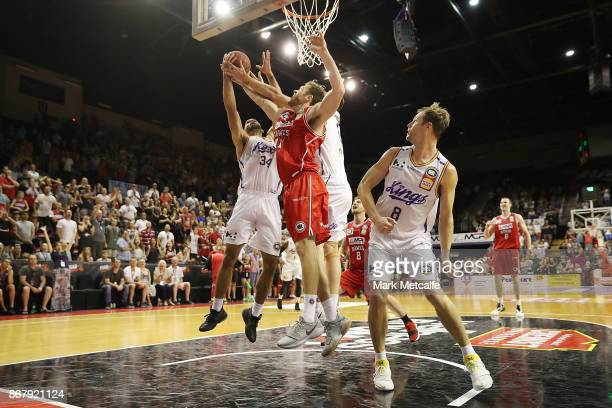 Nick Kay of the Hawks and Perry Ellis of the Kings compete for a rebound during the round four NBL match between the Illawarra Hawks and the Sydney...