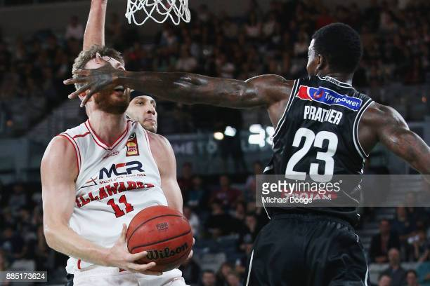 Nick Kay of the Hawks is fouled to the face by Casey Prather of United during the round eight NBL match between Melbourne United and the Illawarra...