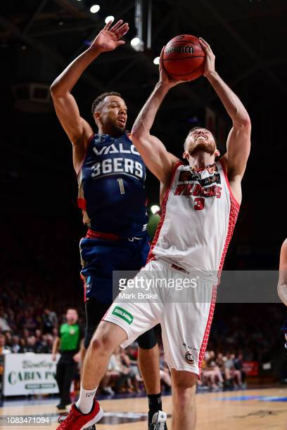 Nick Kay of the Perth Wildcats shoots under pressure from Demitrius Conger of the Adelaide 36ers during the round 14 NBL match between the Adelaide...