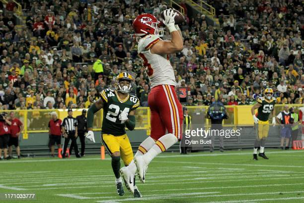 Nick Keizer of the Kansas City Chiefs scores a touchdown past Jackson Porter of the Green Bay Packers in the third quarter during a preseason game at...