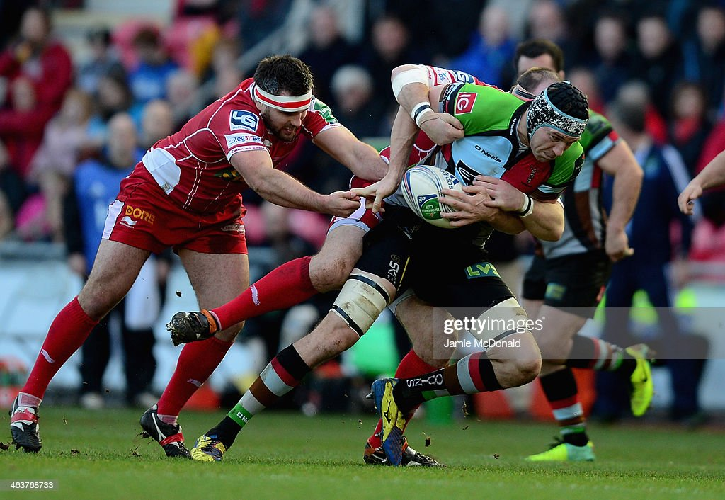 Nick Kennedy of Harlequins is takled by Samson Lee of Scarlets during the Heineken Cup Pool 4 match between Scarlets and Harlequins at Parc y Scarlets on January 19, 2014 in Llanelli, Wales.