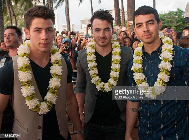 Nick Kevin and Joe of the Jonas Brothers pose for a picture after arriving at the season four premiere of Hawaii Five0 on Queen's Beach Thursday Sept...