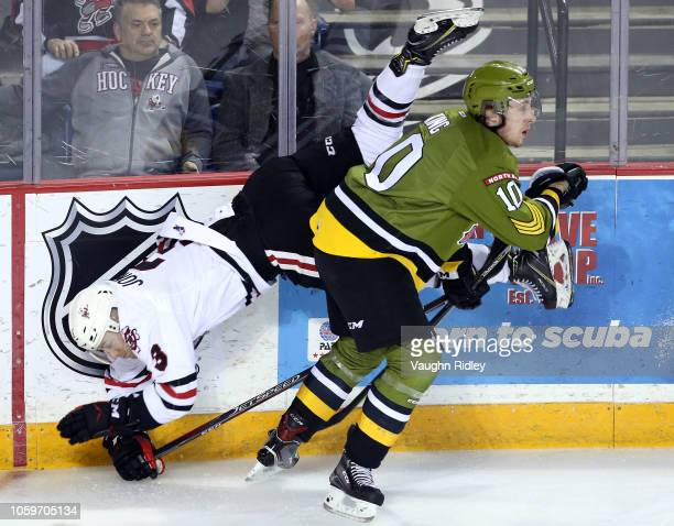 Nick King of the North Bay Battalion checks Ben Jones of the Niagara IceDogs into the boards during the first period of an OHL game at Meridian...