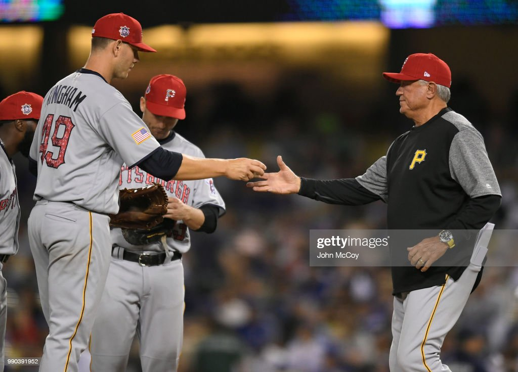 Nick Kingham #49 of the Pittsburgh Pirates is taken out of the game by Pittsburgh Pirates Manager Clint Hurdle in the fourth inning at Dodger Stadium on July 2, 2018 in Los Angeles, California.