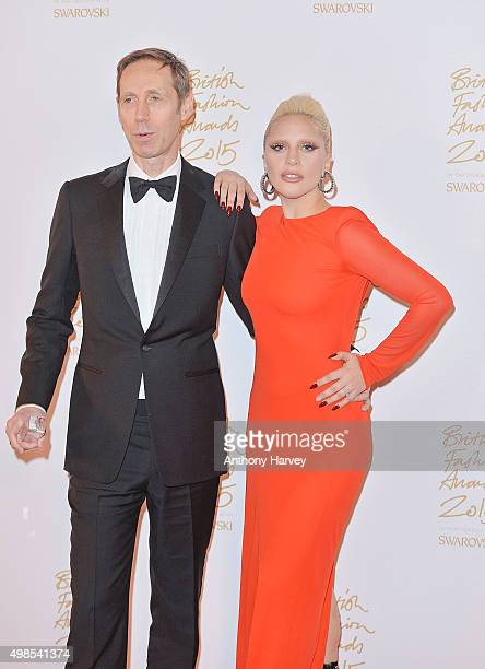 Nick Knight and Lady Gaga pose in the Winners Room at the British Fashion Awards 2015 at London Coliseum on November 23 2015 in London England