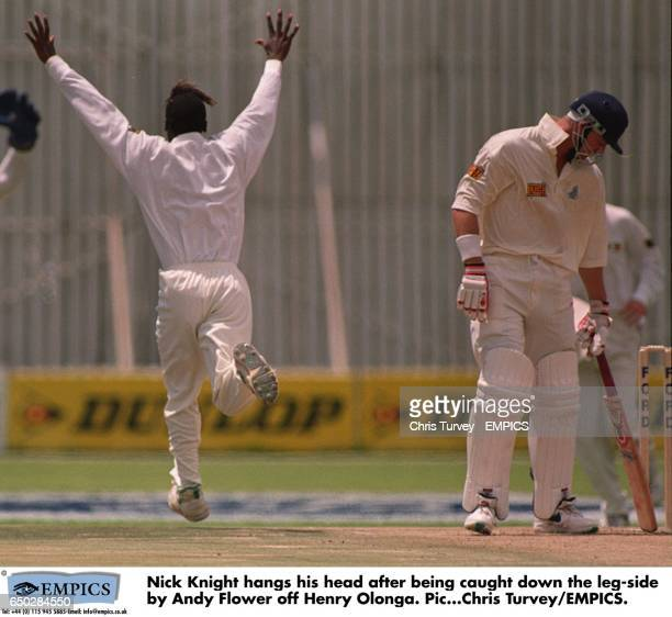 Nick Knight hangs his head after being caught down the leg-side by Andy Flower off Henry Olonga.