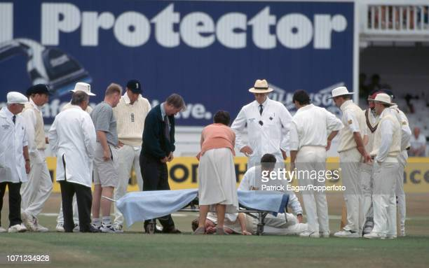 Nick Knight of England receives medical attention after being hit on the head by the ball while fielding in the 5th Test match between England and...
