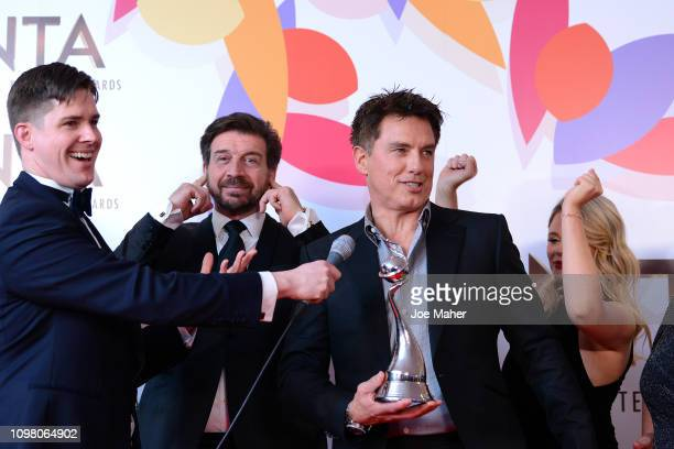 Nick Knowles Emily Atack and John Barrowman pose with The Bruce Forsyth Entertainment Award for I'm A Celebrity… Get Me Out Of Here in the winners...