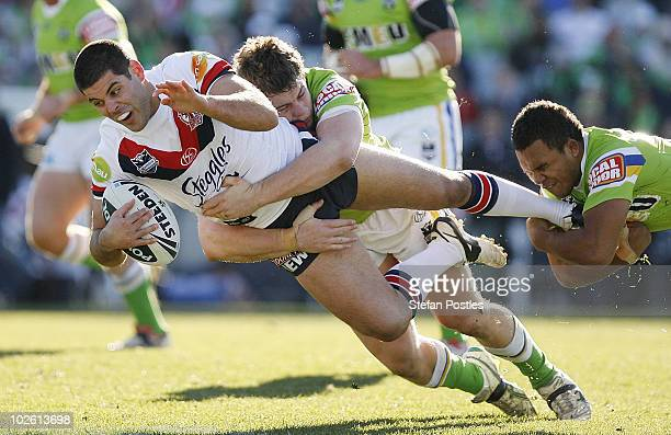 Nick Kouparitsas of the Roosters is tackled during the round 17 NRL match between the Canberra Raiders and the Sydney Roosters at Canberra Stadium on...