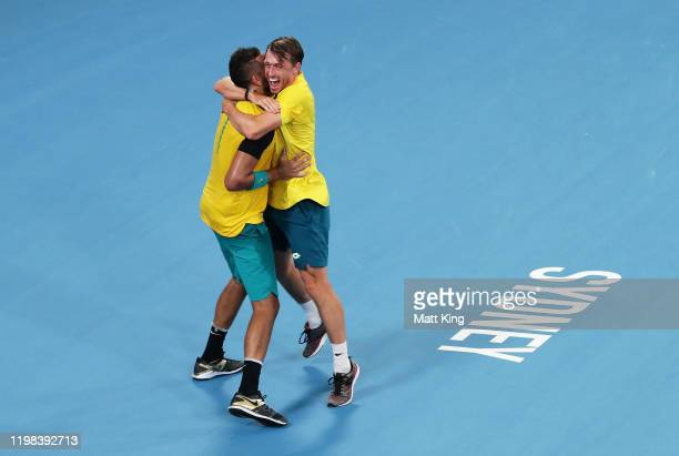 Nick Krygios of Australia celebrates with team mate John Millman after winning match point in their quarter final doubles match against Jamie Murray...