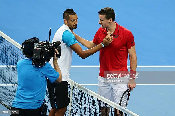 Nick Krygios of Australia Green is congrtaulated by Kenny De Schepper of France after winning the men's single match during day six of the 2016...