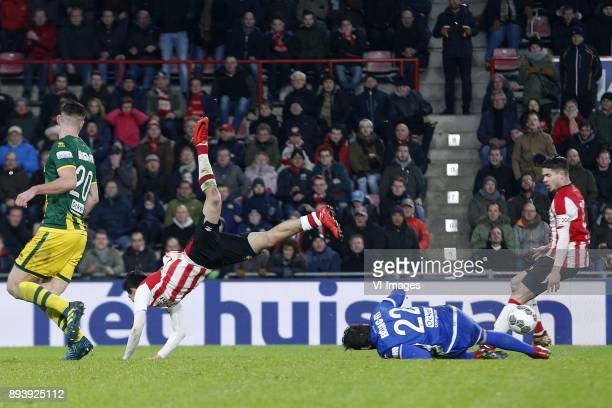 Nick Kuipers of ADO Den Haag Hirving Lozano of PSV Robert Zwinkels of ADO Den Haag Marco van Ginkel of PSV during the Dutch Eredivisie match between...