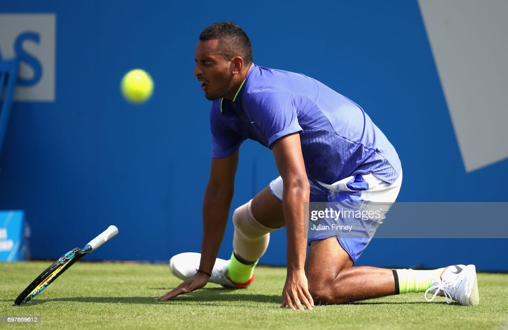 Nick Kygrios of Australia reacts to an injury during the mens singles first round match against Donald Young of The United States during day one of the 2017 Aegon Championships at Queens Club on June 19, 2017 in London, England.