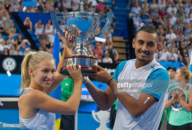 Nick Kyrgios and Daria Gavrilova of the Australia Green team celebrate with the Hopman Cup after defeating Alexandr Dolgopolov and Elina Svitolina of...