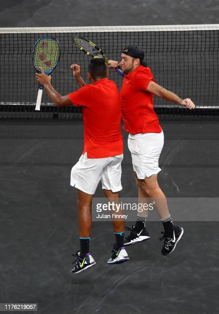 Nick Kyrgios and Jack Sock of Team World celebrate match point in their doubles match against Rafael Nadal and Stefanos Tsitsipas of Team Europe...