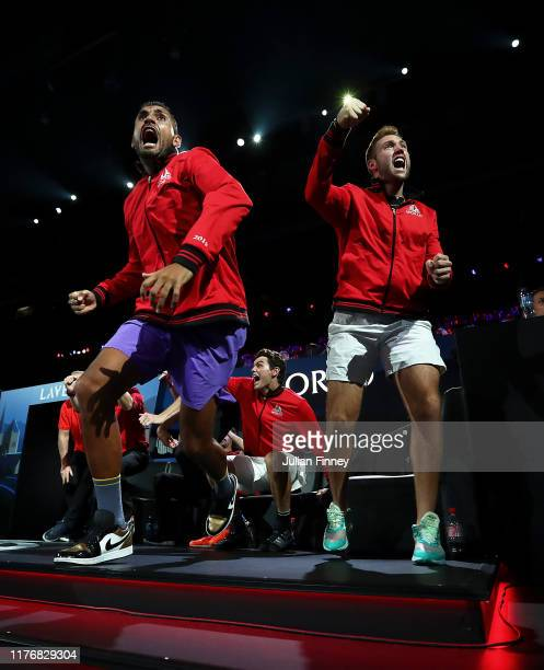 Nick Kyrgios and Jack Sock of Team World react as they watch play during Day Three of the Laver Cup 2019 at Palexpo on September 22, 2019 in Geneva,...
