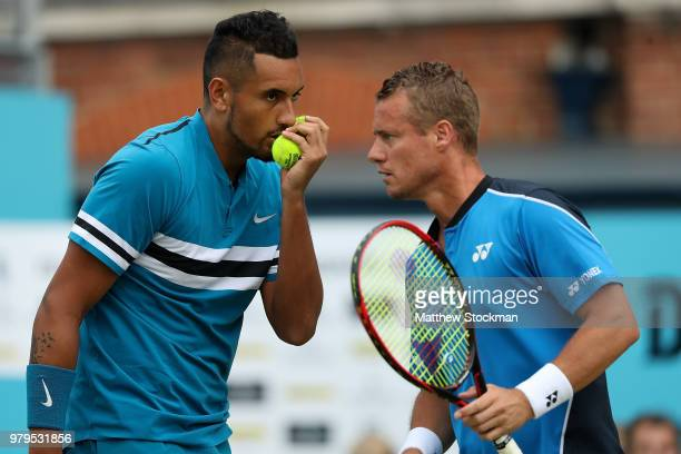 Nick Kyrgios and Lleyton Hewitt of Australia in action during their doubles match against PierreHughes Herbert and Nicolas Mahut of France on Day...