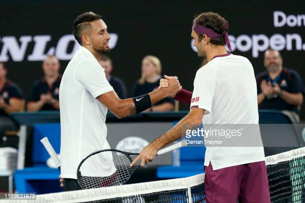 Nick Kyrgios and Roger Federer shake hands after the Rally for Relief Bushfire Appeal event at Rod Laver Arena on January 15 2020 in Melbourne...
