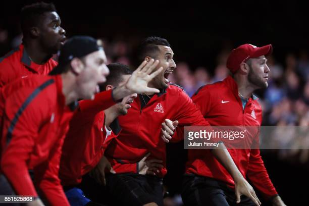 Nick Kyrgios and Team World celebrate from the players bench as John Isner of Team World plays his singles match against Dominic Thiem of Team Europe...