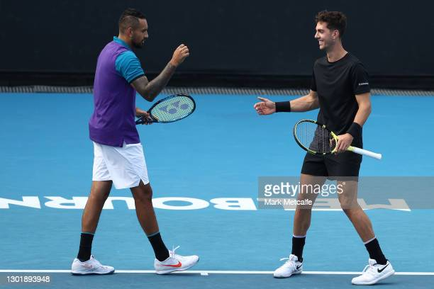 Nick Kyrgios and Thanasi Kokkinakis of Australia celebrate after winning a point in their Men's Doubles second round match against Lloyd Harris of...
