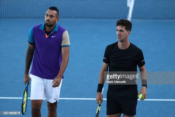Nick Kyrgios and Thanasi Kokkinakis of Australia celebrate look on in their Men's Doubles second round match against Lloyd Harris of South Africa and...
