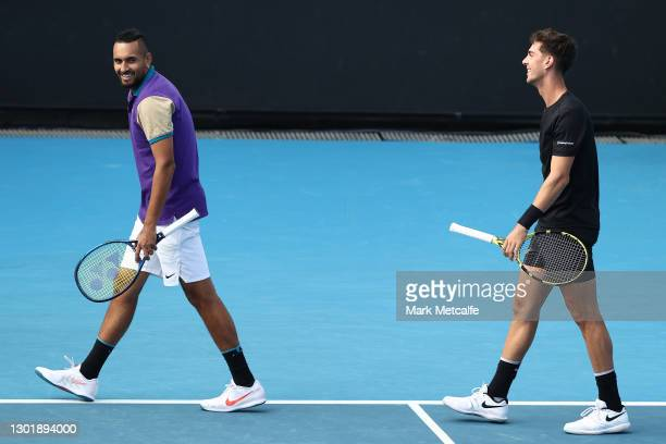Nick Kyrgios and Thanasi Kokkinakis of Australia talk tactics in their Men's Doubles second round match against Lloyd Harris of South Africa and...