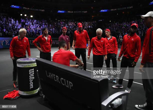 Nick Kyrgios is surrounded by a dejected Team World after his loss to Roger Federer of Team Europe during the final day of the Laver Cup at the O2...
