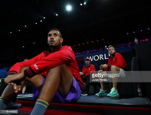 Nick Kyrgios, Jordan Thompson and Jack Sock of Team World react as they watch play during Day Three of the Laver Cup 2019 at Palexpo on September 22,...