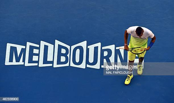 Nick Kyrgios of Australia adjusts the strings in his racket as he plays Andy Murray of Britain in their men's singles match on day nine of the 2015...