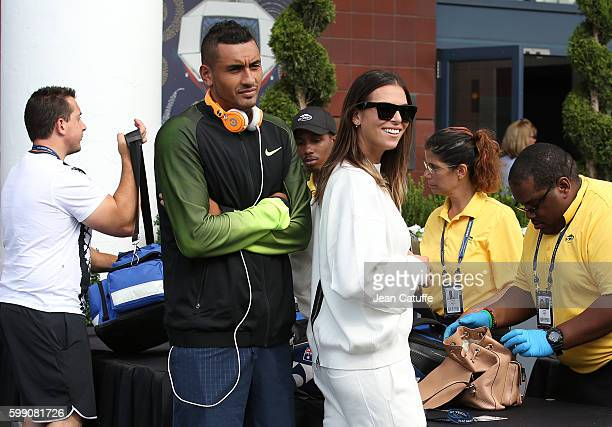 Nick Kyrgios of Australia and Ajla Tomljanovic arrive together at Arthur Ashe Stadium on day 6 of the 2016 US Open at USTA Billie Jean King National...