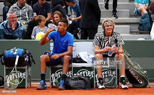 Nick Kyrgios of Australia and Alexander Zverev of Germany take a break during the Men's Singles second round match against Pablo Carreno Busta and...