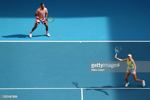 Nick Kyrgios of Australia and Amanda Anisimova of the United States play in their Mixed Doubles second round match against Barbora Krejcikova of...