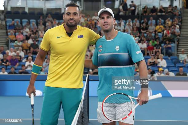 Nick Kyrgios of Australia and Cameron Norrie of Great Britain pose during the coin toss before their quarter final singles match during day seven of...