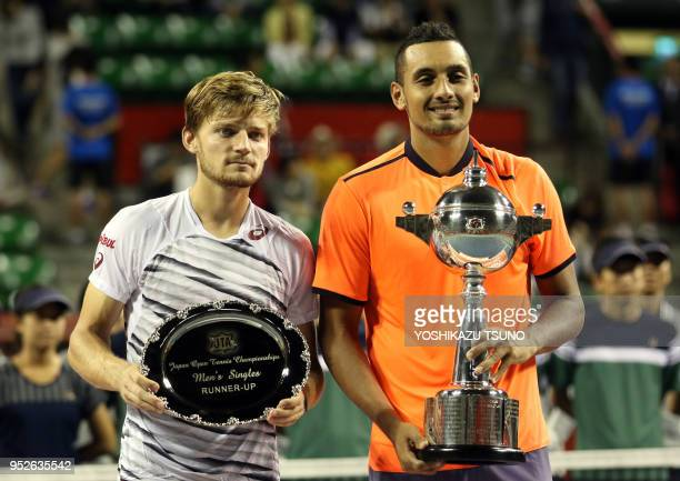 Nick Kyrgios of Australia and David Goffin of Belgium hold the trophy of the Rakuten Japan Open tennis championships in Tokyo on October 9 2016...