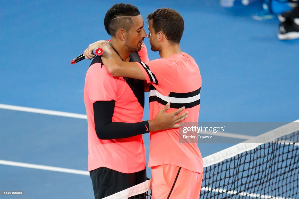 Nick Kyrgios of Australia and Grigor Dimitrov of Bulgaria embrace after their fourth round match on day seven of the 2018 Australian Open at Melbourne Park on January 21, 2018 in Melbourne, Australia.
