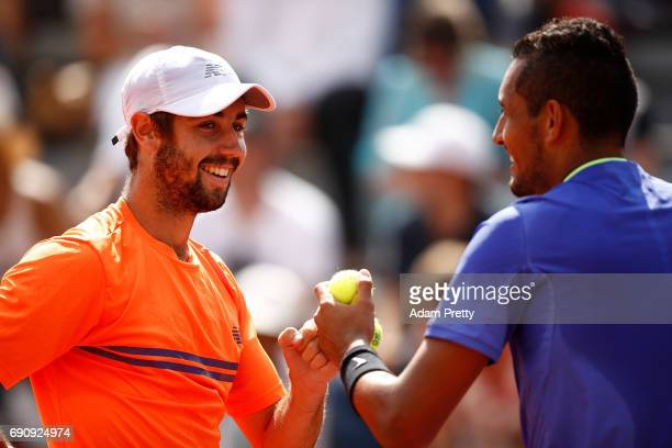 Nick Kyrgios of Australia and Jordan Thompson of Australia speak tactics during the doubles first round match against PierreHugues Herbert and...