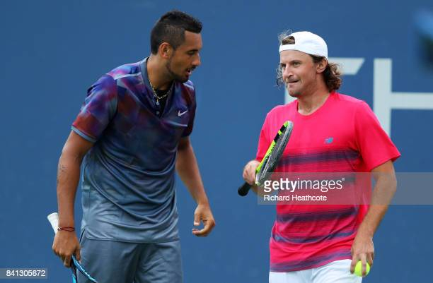 Nick Kyrgios of Australia and Matt Reid of Australia react against Joao Sousa of Portugal and JanLennard Struff of Germany during their first round...
