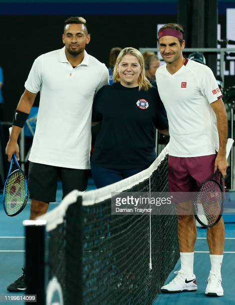 Nick Kyrgios of Australia and Roger Federer of Switzerland pose at the net during the Rally for Relief Bushfire Appeal event at Rod Laver Arena on...