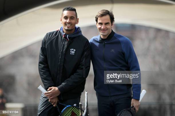 Nick Kyrgios of Australia and Roger Federer of Switzerland pose for photos during the Laver Cup 2018 Chicago Launch at Cloud Gate on March 19 2018 in...